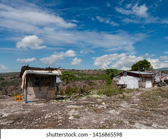 Mountain shacks, the one to the left is a shop, at a dry mountain landscape in Maasim, Sarangani Province on Mindanao, the southernmost large island of the Philippines.