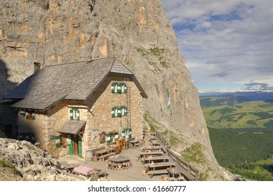 Mountain shelter  in the Dolomites, Alps, Italy, with highlands and mountains in the background