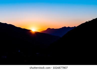 Mountain silhouette of Himalayan peaks during sunrise from Pantwari asmall hamlet near Mussoorie, Garhwal region, Uttarakhand, India.