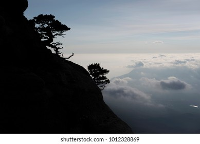 Mountain silhouette on the background of clouds and sky.