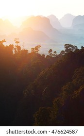 Mountain silhouettes at sunset in Thailand.