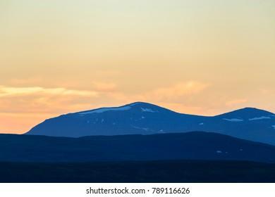 Mountain silhouettes in twilight