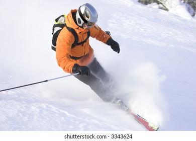 mountain ski rider in orange sharp stop