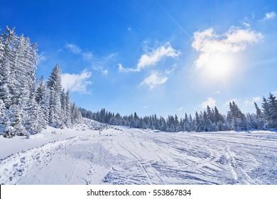 mountain ski slope on a sunny day. Winter mountain landscape