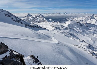 Mountain skiing - panoramic view from Plateau Rose at  the ski slopes and Cervinia, Italy, Valle d'Aosta, Breuil-Cervinia, Aosta Valley, Cervinia