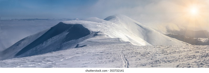 mountain slopes in winter on a sunny afternoon in carpathians