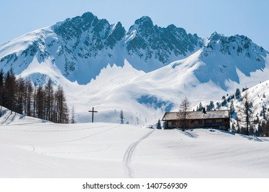 Mountain and small house during winter
