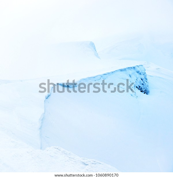 Mountain in snow with fog. Winter landscape