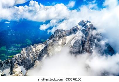 Mountain snow top in cloud landscape