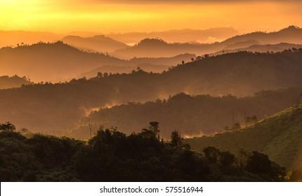 Mountain soft fog scenic sunrise morning at thongphaphum, kanchanaburi, thailand Mountain hill viewpoint scenic landmark .