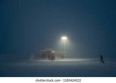 Mountain sports resort in a haze looking like a spaceship. Twilight. Wintry landscape. Lapland.