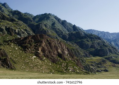 Mountain stone grassy valley in a summer sunny day. Altay, Russia