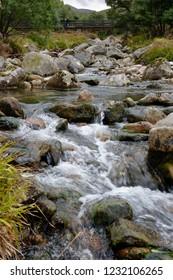 Mountain Stream Allt Mor and Utsi's Bridge on Sugarbowl Trail Glen More, Cairngorms, Scotland