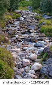 Mountain Stream Allt Mor viewed from Utsi's Bridge on Sugarbowl Trail Glen More, Cairngorms, Scotland