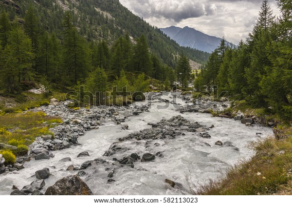 Mountain stream (Evancon) in the Monte Rosa Massif (Ayas Valley, Italy).