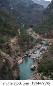 Mountain stream full of smooth rocks in Yerkopru Canyon in Mut, Mersin Turkey