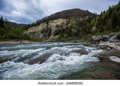 Mountain stream on the background of mountains
