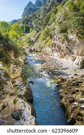 The mountain stream Rio Cares runs through the valley in the foothills of the National Park Picos de Europa. Also the foothills are a popular hiking destination and leads along the Camino de Santiago