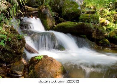 mountain stream running over mossy rocks in siberia (foothills of Sayan's mountain range)