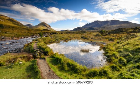 The mountain stream at Sligachan flowing from the Red Cuillin Hills of Scotland's Isle of Skye.