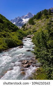 Mountain stream in Val Vény (Aosta Valley, Italy). In the background, Aiguille des Glaciers (3,816 m - 12,520 ft), in the Mont Blanc Massif.