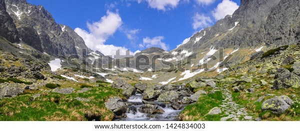 mountain-stream-valley-remaining-snow-60