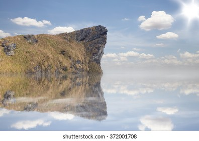 Mountain submerged with blue sky background
