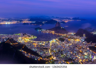 The mountain Sugarloaf and Botafogo in Rio de Janeiro, Brazil. Sugarloaf is one of the main landmark of Rio de Janeiro. Night skyline of Rio de Janeiro