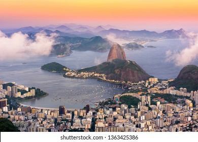 The mountain Sugarloaf and Botafogo in Rio de Janeiro at sunset, Brazil. Sugarloaf is one of the main landmark of Rio de Janeiro. Sunset skyline of Rio de Janeiro