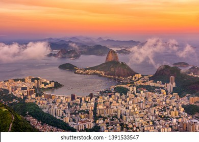 The mountain Sugarloaf and Botafogo in Rio de Janeiro at sunset, Brazil. Sugarloaf is one of the main landmark of Rio de Janeiro. Skyline of Rio de Janeiro