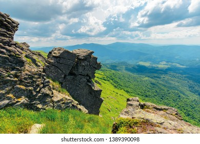mountain summer landscape. meadow with huge boulders among the grass on top of the hillside near the peak of mountain ridge