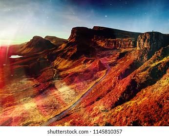 Mountain sunset at Isle of Skye, Scottish highlands. Tourist hiking around  valley.  Hipster filter.