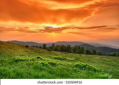 Mountain sunset in orange colors.