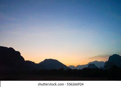 the mountain with sunset at vang vieng, laos