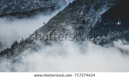 Mountain swimming in thick mist