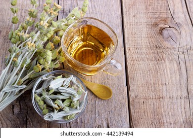 Mountain tea. Herbal tea Sideritis and flowers on wooden background,selective focus
