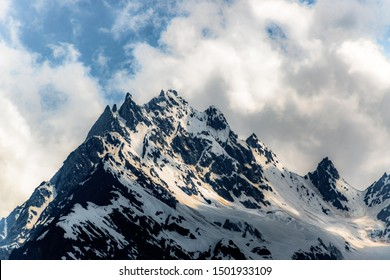 Mountain top with clouds at Badrinath