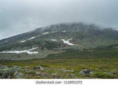 Mountain top covered in clouds