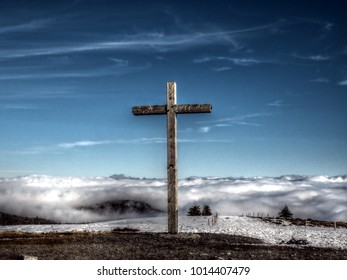 Mountain top cross - high dynamic range image of a crucifix at the summit  of the Belchen in the Black forest, Germany.
