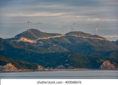Mountain top row of wind turbines on China's Jintang Island in Zhejiang Province