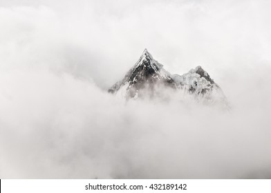 Mountain top surrounded by clouds