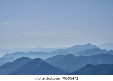 Mountain tops covered in morning haze seen from the top of the Panoramastrasse on Mt. Goldeck