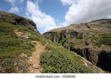 Mountain trail in Iceland. Hiking footpath next to Glymur canyon. Beautiful landscape.