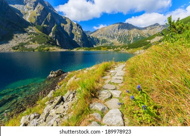 Mountain trail from Morskie Oko to Czarny Staw lake in summer, High Tatra Mountains, Poland