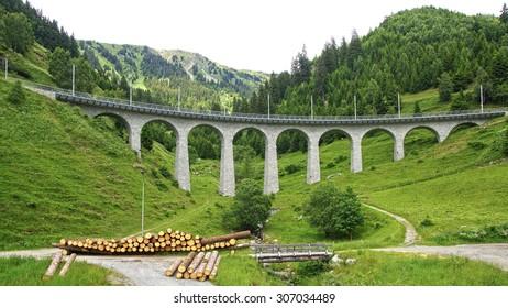 Mountain train Viaduct in the Swiss Alps. Switzerland