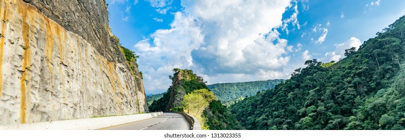 Mountain traversed by road in the way Villeta - Bogota, Cundinamarca framed by rock and forest