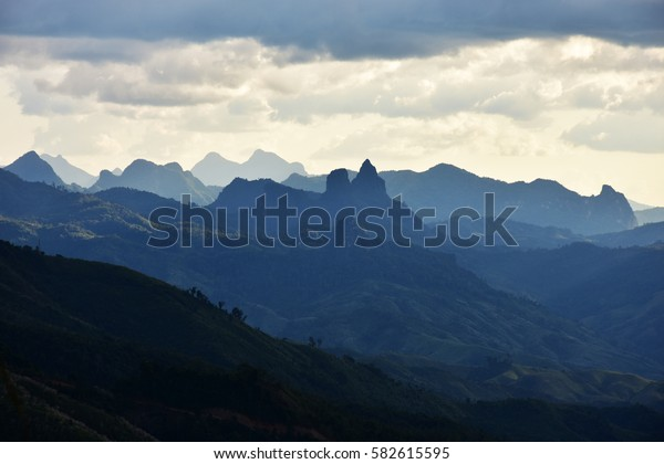Mountain under a blue sky in Laos.