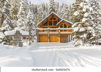 Mountain vacation homes covered with snow, winter wonderland. Ski or golf resort.