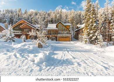 Mountain vacation log houses at ski resort or golf course. Winter wonderland.