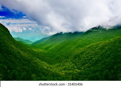 Mountain valley with clouds. Tropical landscape